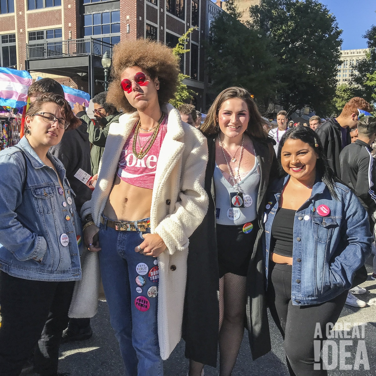 Attendees at Greensboro Pride wear A Great Idea voter pins